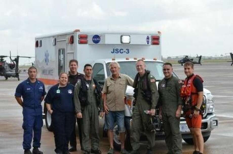 A rescued man stands with the Air Station Houston aircrew that saved him and HD video of b-roll and interview with one of the helicopter pilots that came to his rescue. U.S. Coast Guard video by Petty Officer 1st Class Andrew Kendrick.