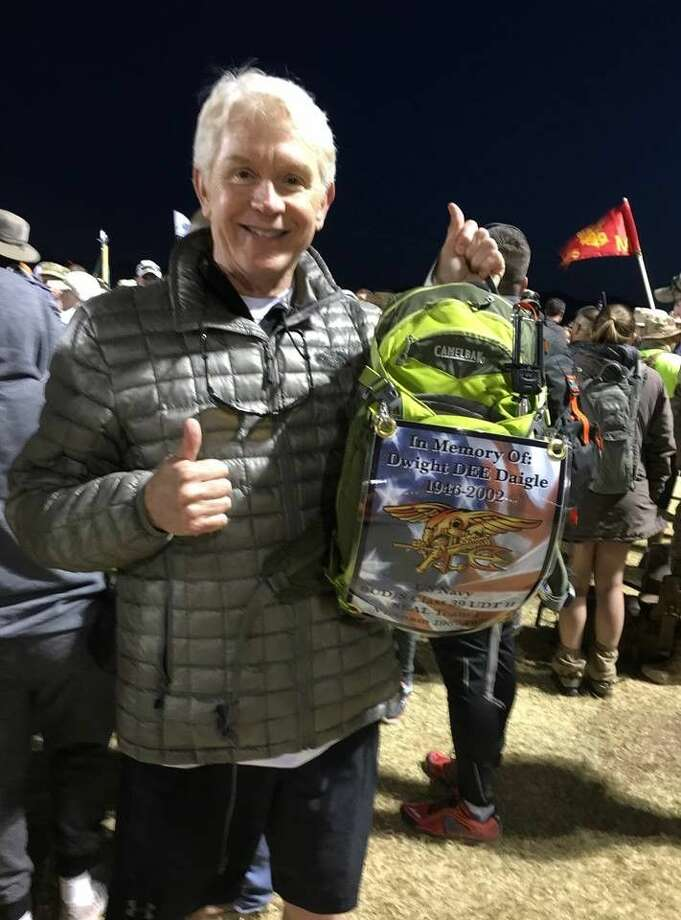 Carrying a placard in honor of his late brother-in-law, Kingwood resident Dr. Charles Campbell has marched alongside active military while honoring those who have died serving their country as a part of the Bataan Death March for the past two years.