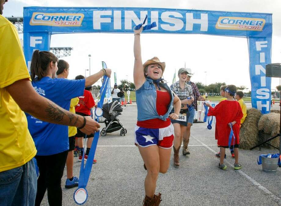The Country Store held a 5K Run and country festival at NRG Park in Houston as part of their 2014 Fun Run series. Race participants are encouraged to come donning their favorite western duds. Photo: John Everett