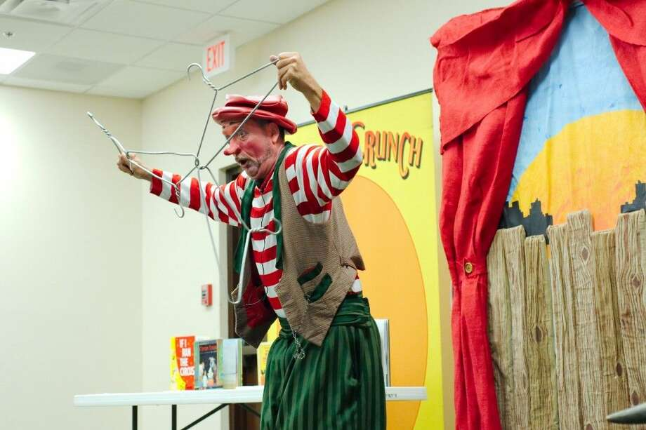 Former circus clown Bonzo Crunch performs at the Helen Hall Library in League City Thursday, July 21.