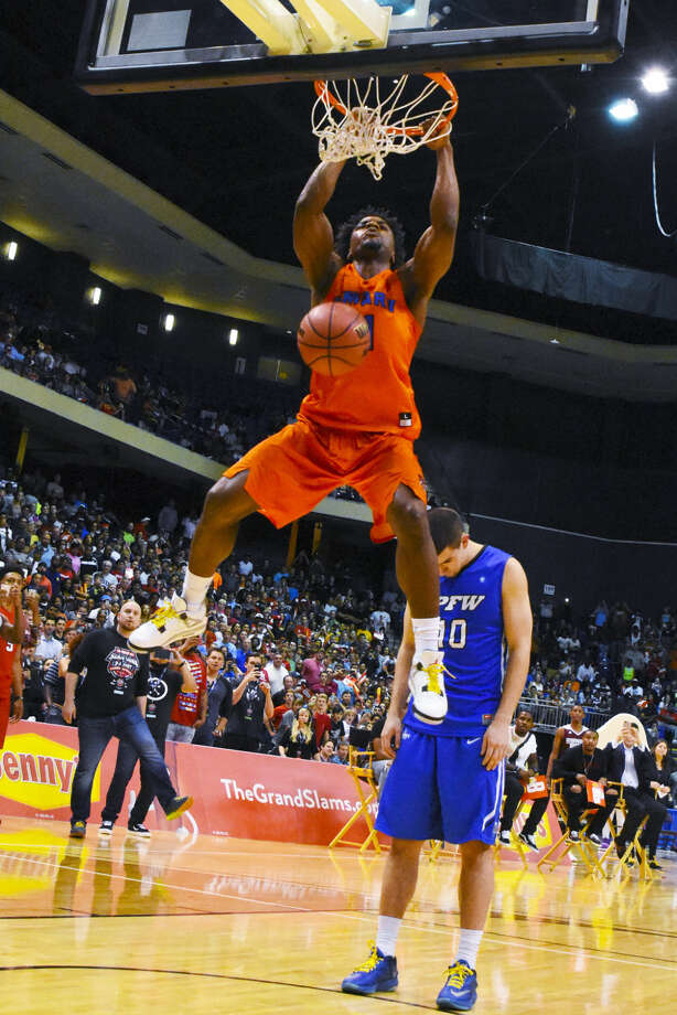 University of Mary senior guard Devan Douglas earned top dunking honors at the College Slam Dunk and 3-Point Championship Thursday, defeating UNLV's Ike Nwamu in the finals. Photo: Tony Gaines