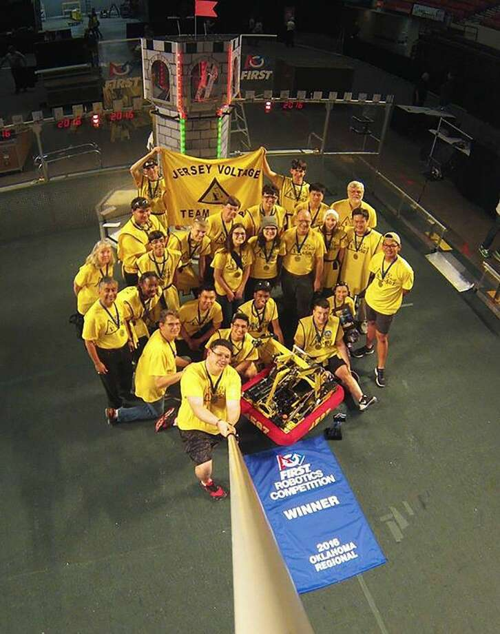 The Jersey Village High School robotics team, the Jersey Voltage, celebrates its victory at the 2016 Oklahoma Regional for the FIRST Robotics competition March 25 in Oklahoma City.