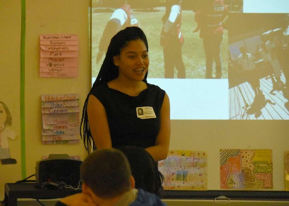 Jendai Robinson, a NASA fellow and STEM role model for JASON Learning, speaks to eighth-grade students at Thornton Middle School about STEM career paths on March 31.