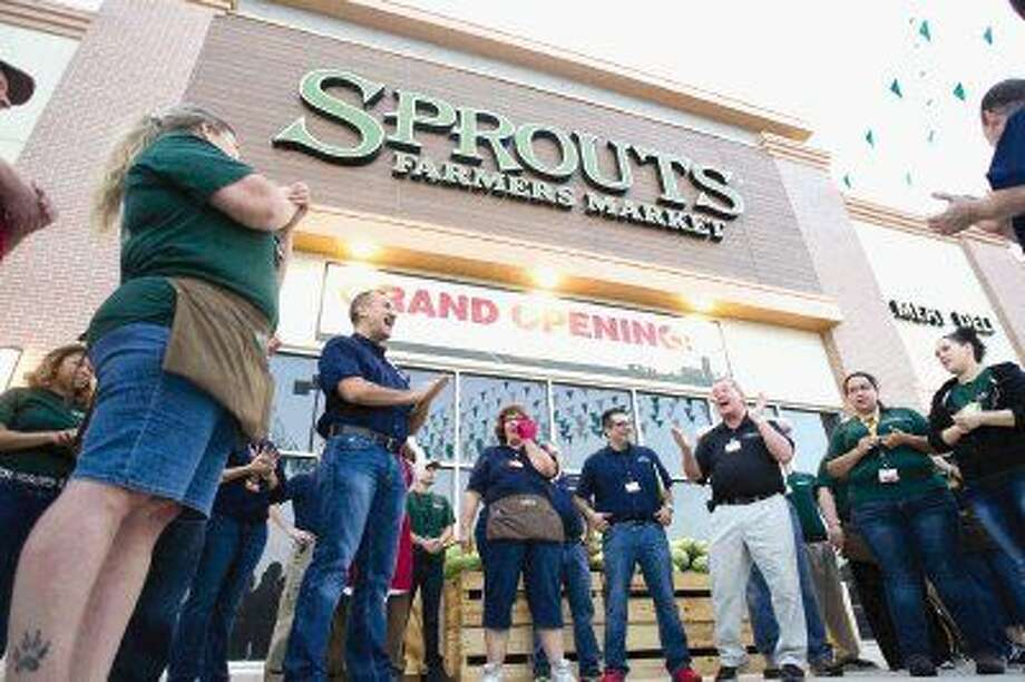 Sprouts employees gather before the opening of the new farmers market in Spring Wednesday. Photo: Jason Fochtman