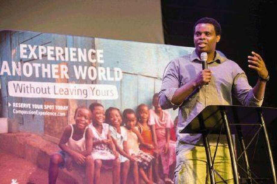 Ben Mwangi, a teaching assistant and graduate student at the University of Colorado in Colorado Springs, speaks about Compassion Experience on Monday at First Baptist Church Conroe. Mwangi was sponsored as a child himself by Compassion, which gave him the resources to excel and become the physicist and advocate that he is today. Photo: Michael Minasi