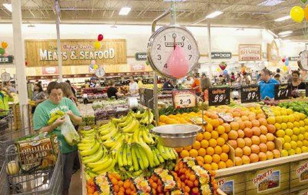 Shoppers gather groceries at a Sprouts Farmers Market in Spring.