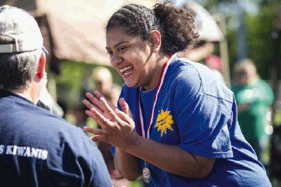 Vivian Zepeda, of the New Caney Nitros, reacts after receiving a medal during the annual Kiwanis Invitational Athletics Competition on Saturday at Oak Ridge High School.