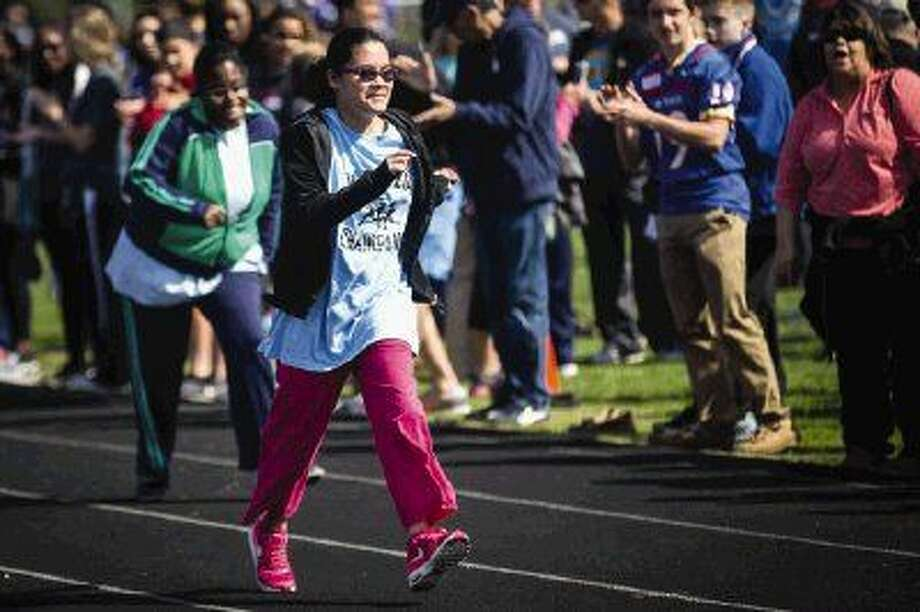 Serena Rivera, of the Magnolia Champions, places first in the 50 meter dash during the annual Kiwanis Invitational Athletics Competition on Saturday at Oak Ridge High School.