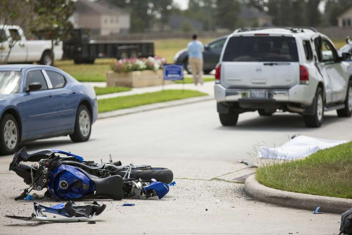 A destroyed sportbike sits in the street at the scene of a fatality accident involving a motorcycle and SUV on Aug. 21, 2014, at the intersection of Will Clayton Parkway and Silver Bend Drive. The motorcyclist died at the scene.