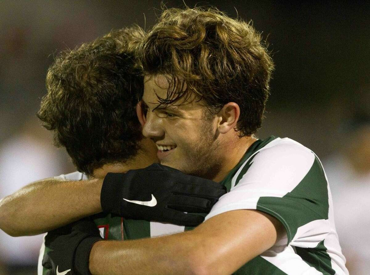 The Woodlands midfielder Nicholas Pekel hugs Keno Tamez after his assist led to Tamez's goal in the second period of a Region II-6A area round playoff game at A&M Consolidated High School Friday in College Station. The Woodlands defeated Round Rock McNeil 2-1. Go to HCNpics.com to purchase this photo and others like it. \rr5