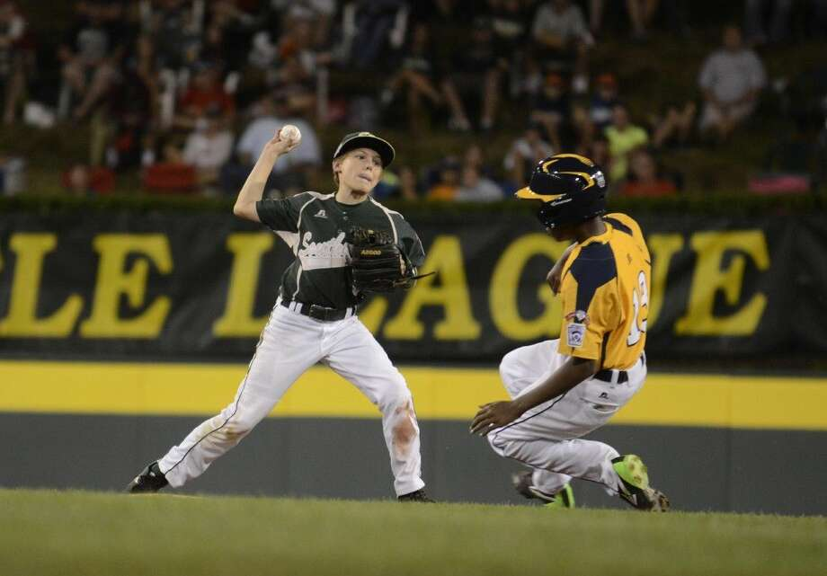 Brandon Sliwinski (8) throws for a double play during Tuesday's Little League World Series game in Williamsport, Pa. on August 19, 2014. (Ralph Wilson)