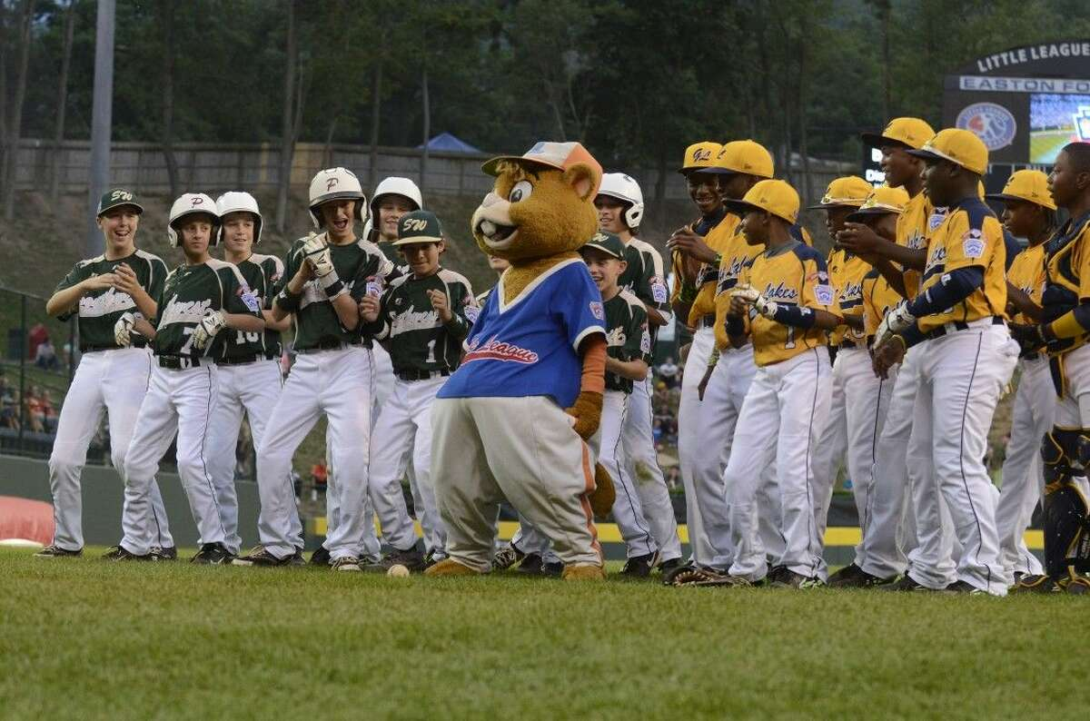 Little League mascot Dugout dances with Southwest and Great Lakes players at the beginning of Tuesday's Little League World Series game in Williamsport, Pa. on August 19, 2014. (Ralph Wilson)