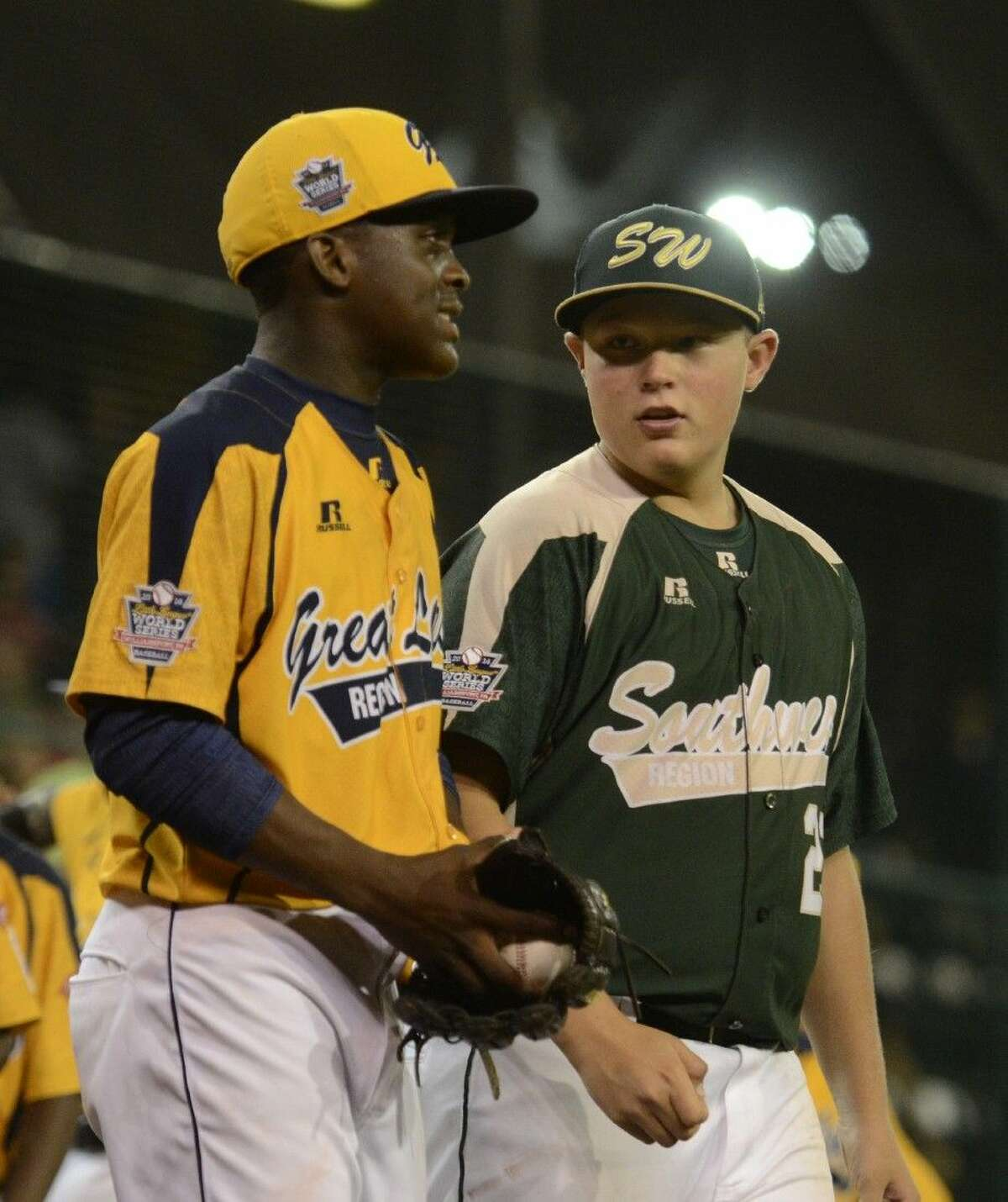 Walter Maeker III (21) congratulates Great Lakes pitcher Joshua Houston at the end of Tuesday's Little League World Series game in Williamsport, Pa. on August 19, 2014. (Ralph Wilson)