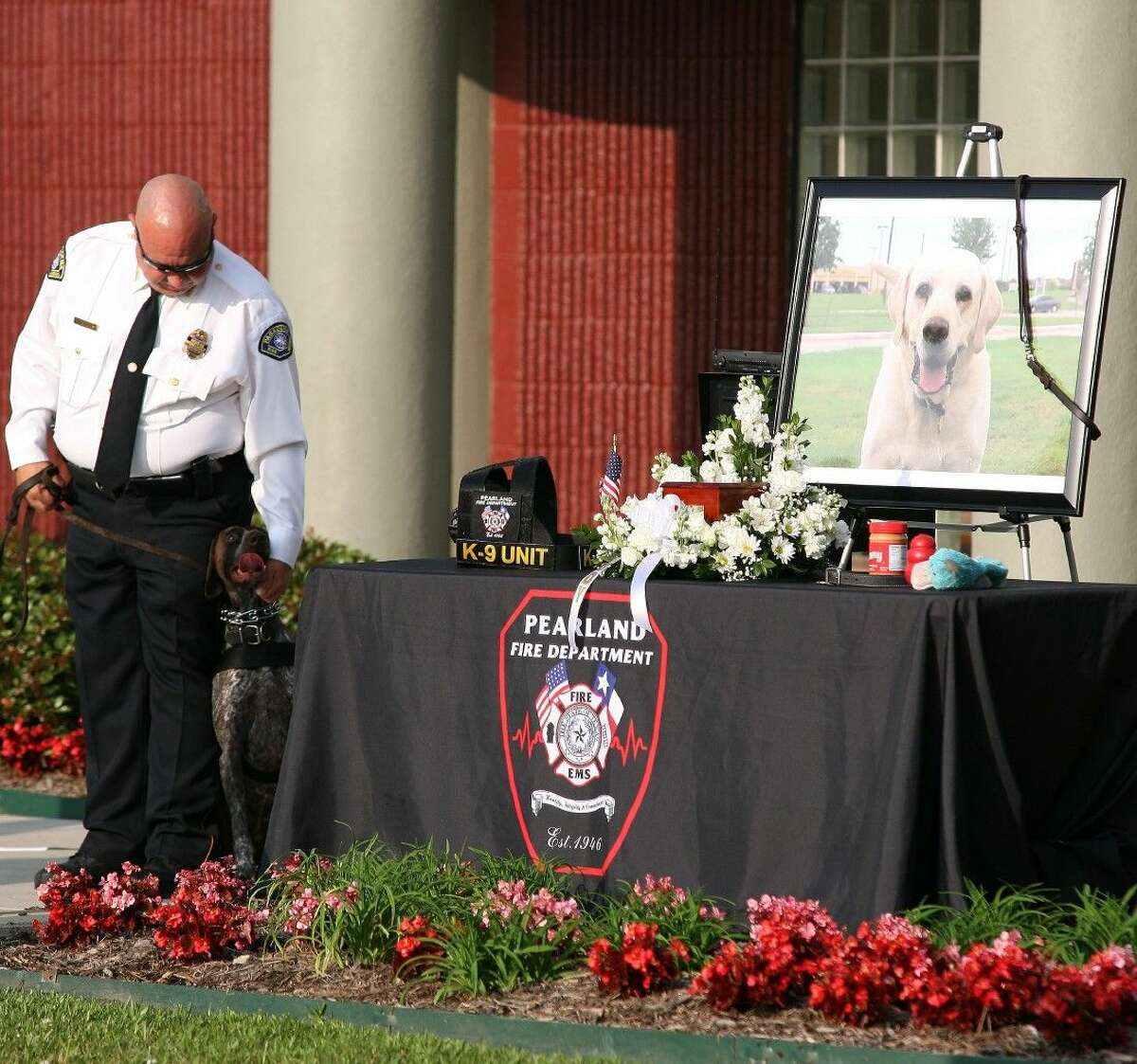 A Pasadena Deputy Fire Marshal and his K9 were one of several that stood at the memorial throughout the service.