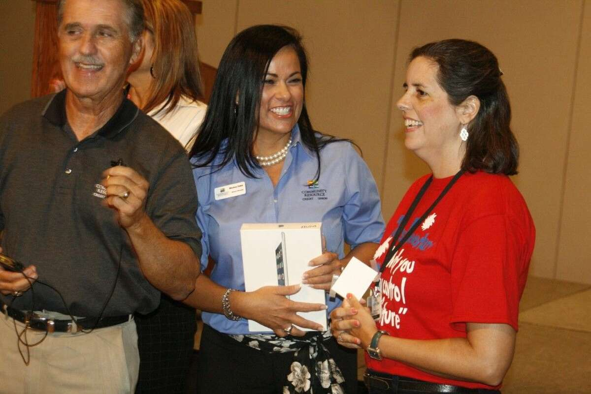 To get the school year off on the right foot, representatives from Community Resource Credit Union surprised a few select teachers with new iPads at Convocation Aug. 19, 2014.