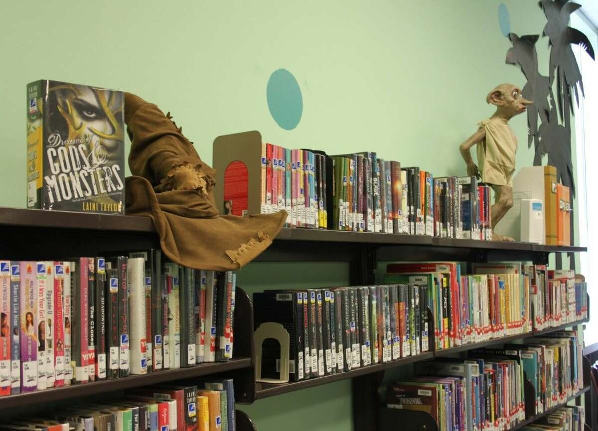 Dobby the elf and a sorting hat from the Harry Potter books series decorate the top shelf of the teen area at Austin Memorial Library in Cleveland. Those items, as well as some of the books in the teen collection, are being questioned by a Shepherd minister.