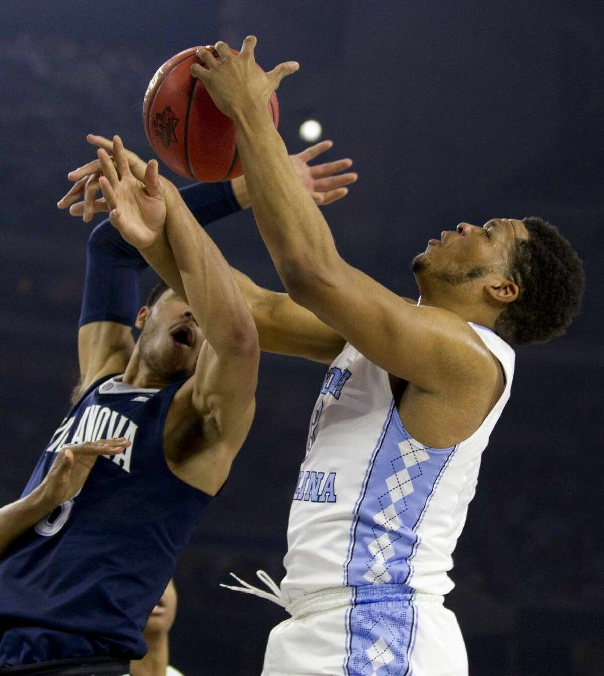 North Carolina forward Kennedy Meeks grabs a rebound over Villanova guard Josh Hart during the first half of an NCAA Final Four national championship college basketball game on Monday at NRG Stadium in Houston.