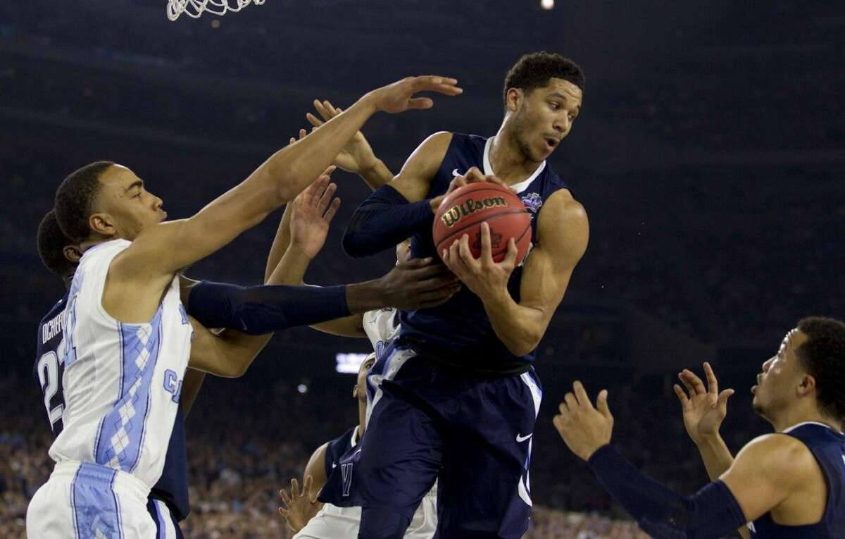 Villanova guard Josh Hart grabs a rebound during the first half of an NCAA Final Four national championship college basketball game on Monday at NRG Stadium in Houston.