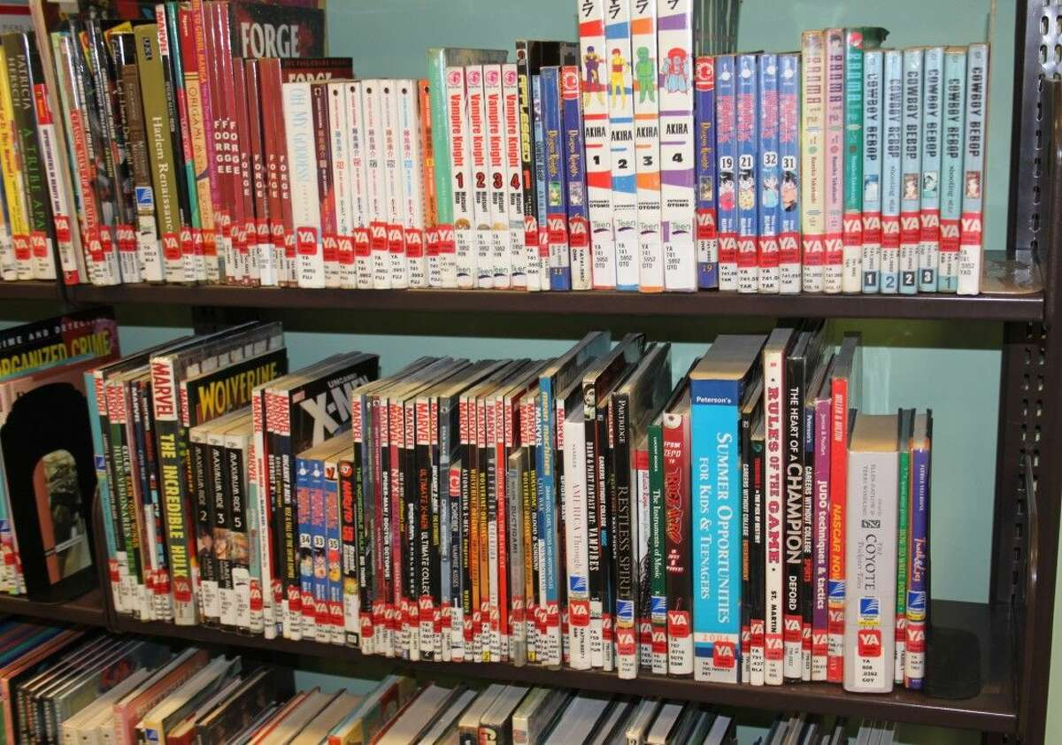 A shelf of Marvel and DC comic books is part of the teen collection at Austin Memorial Library.