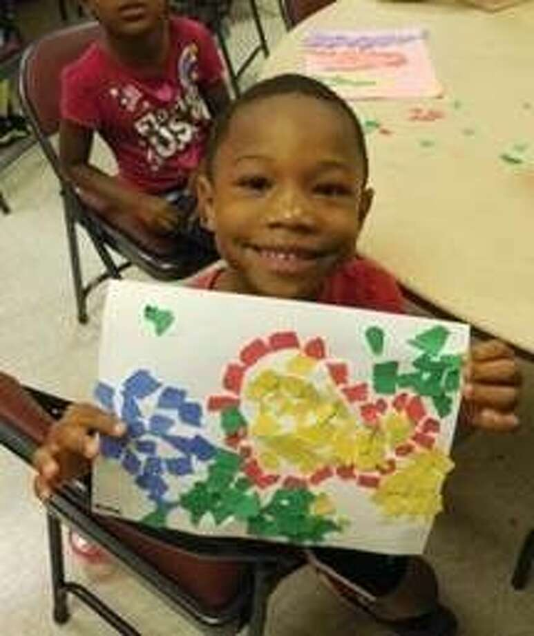 A young enrollee of Missouri City's Rec Kids after-school program poses with his artistic creation. Photo: Image Courtesy Missouri City