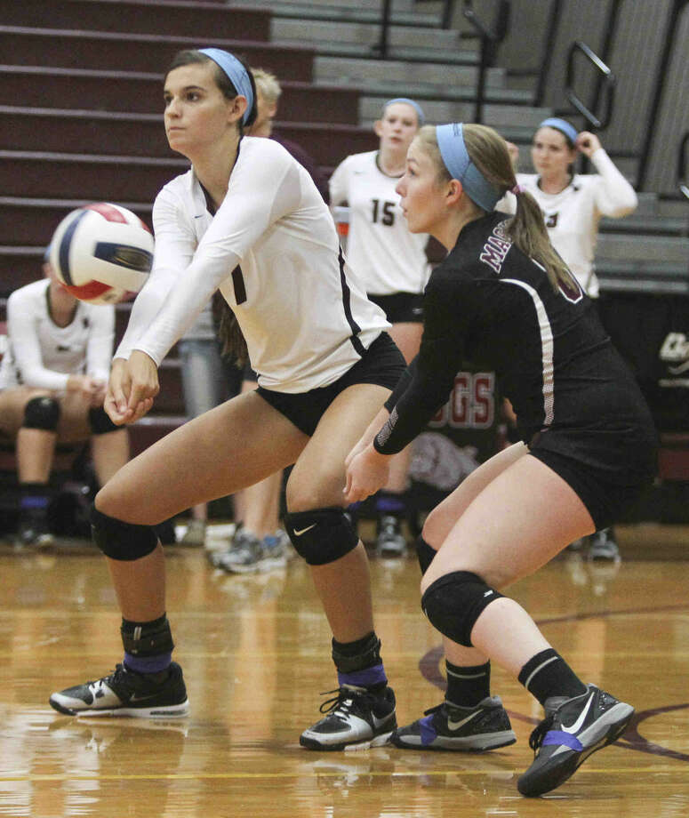 Magnolia's Morgan Miller returns a serve during a game at the Magnolia Volley Battle at Magnolia High School Thursday. To view or purchase this photo and others like it, visit HCNpics.com. Photo: Jason Fochtman