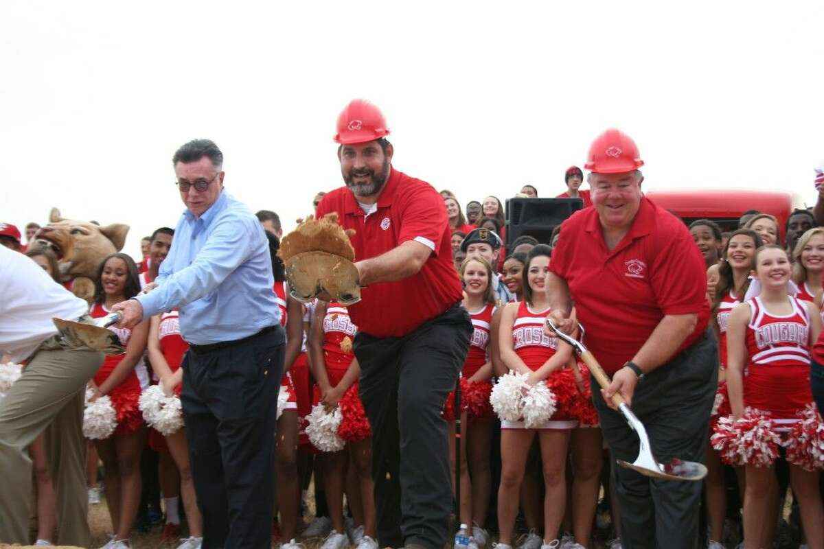 Crosby Independent School District superintendent Dr. Keith Moore (center) and Crosby ISD board president Dan Kasprzak (right) break ground on the new Crosby High School.