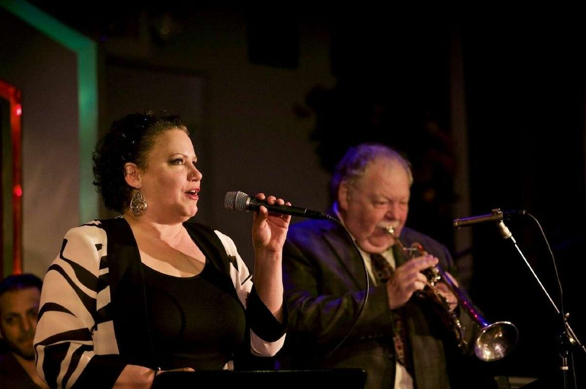 Sheri Lavo sings with Dennis Dotson of the Larry Slezak Hammond Organ Band on trumpet on March 20 at Ovations in Rice Village. The performance was a benefit for Slezak.
