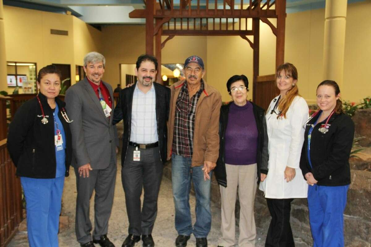 From left, Josephine Kotico (RNCV/Neuro ICU), Harold Engle (MBA, RN Director Neuro & Cardiac), Dr. Luis Vaca (MD Neuro Interventional Radiologist), Mr. Juan Silva (patient), Mrs. Mariana Silva (wife), Andrea Colburn (APRN, ACNP CV/Neuro Nurse Practitioner) and Robyn Clymer (RN CV/Neuro ICU.)