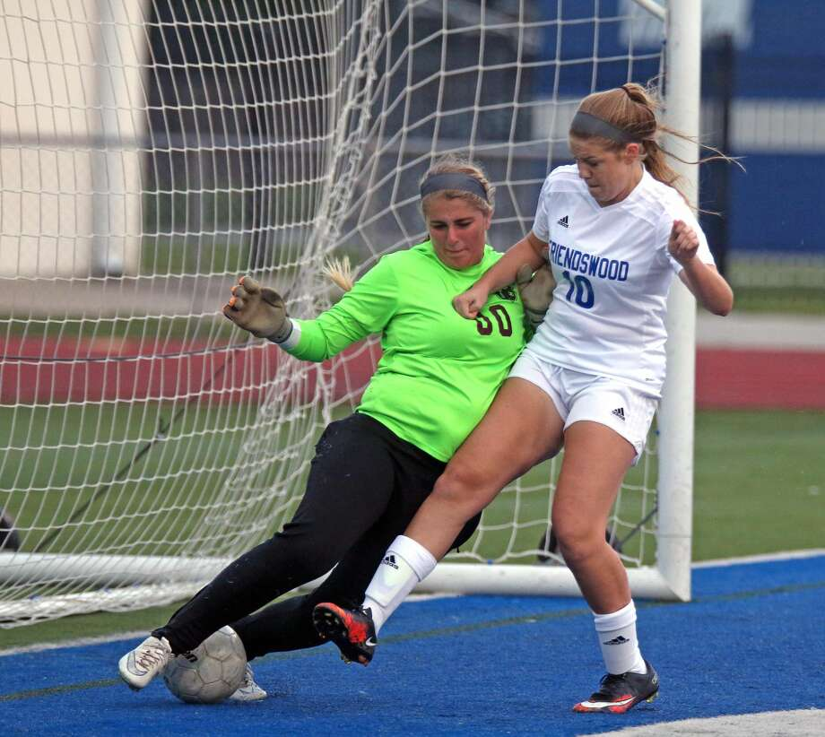 While Friendswood's Olivia Rhodes (10) puts pressure on the goalkeeper, the kick by Reid Kohls manages to go between her feet for Kohls' first goal. Photo: Kar B Hlava