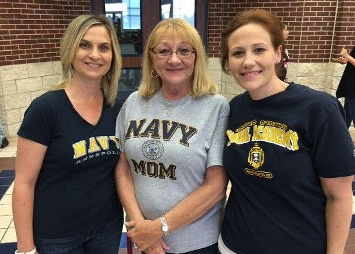 Berry Miller Junior High (from left) principal Kim Brooks, teacher Silvia Goodwyne and counselor Sarah Kierkiewicz sport denim and U.S. Navy shirts for