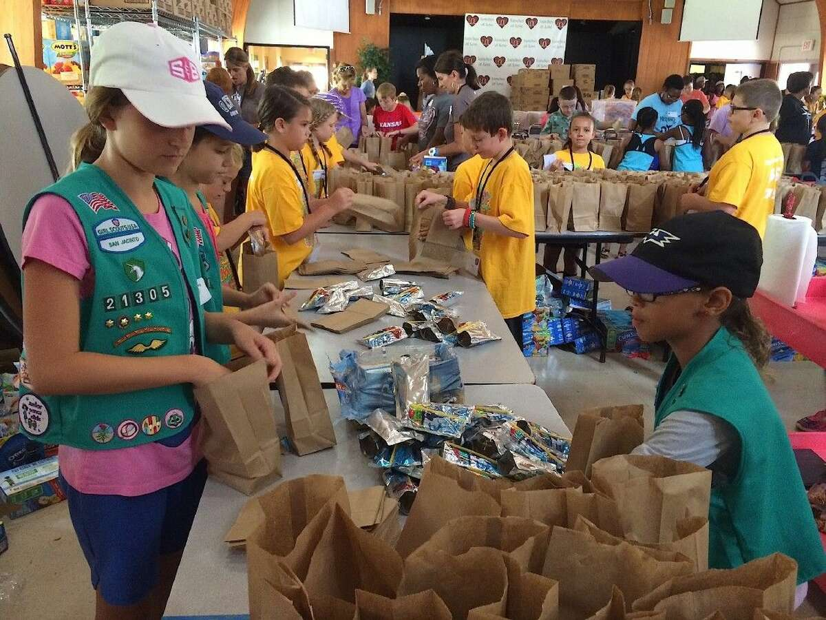 The Scouts filled 3,400 snack sacks for Lunches of Love.