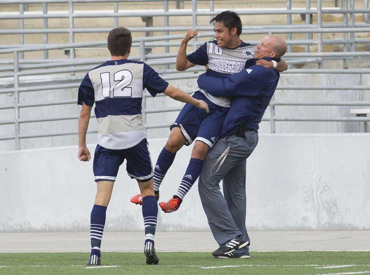 College Park's Rodrigo Perez, center, is lifted up in the air by head coach John Owens after Perez's first period goal during a District 16-6A boys soccer game against Oak Ridge Tuesday. College Park defeated Oak Ridge 3-1. Go to HCNpics.com to purchase this photos, and other like it.