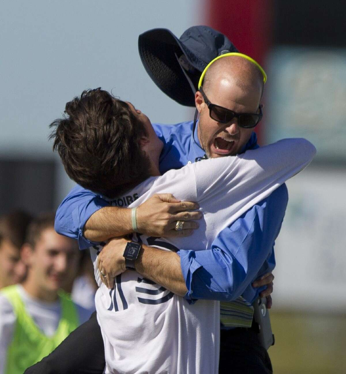 College Park coach John Owens celebrates a goal with Andrew Chodorow in a 3-2 overtime loss to Westfield high school.