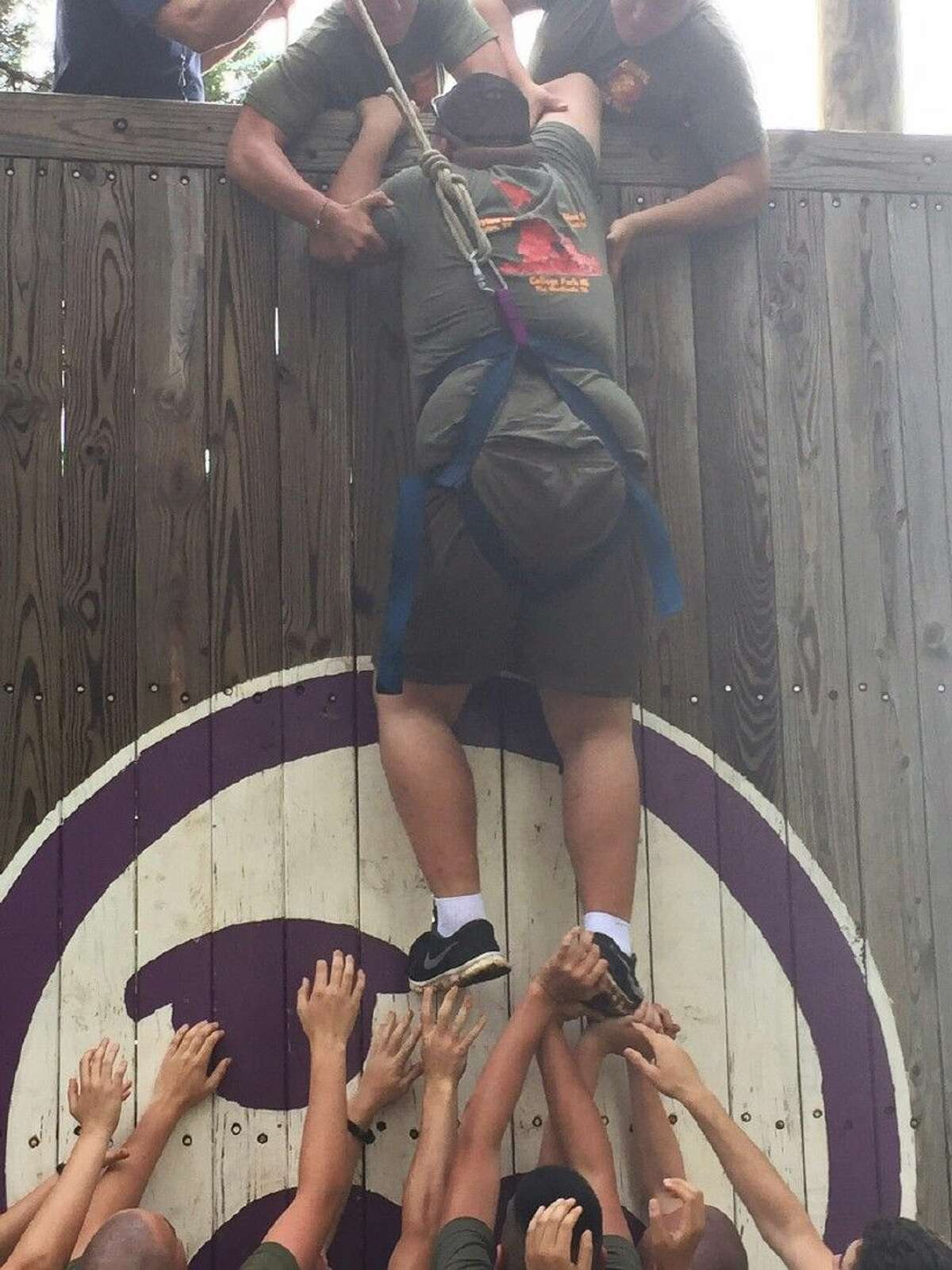Cadet Corporal Arrizoloa scales a wall during a team-building exercise at the JROTC Cadet Leadership Camp in New Braunfels, Texas.