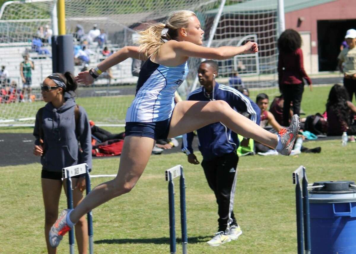 Mustang Emme Pratt clears a hurdle in the 300 meter hurdles at the College Park Invitational on Saturday.