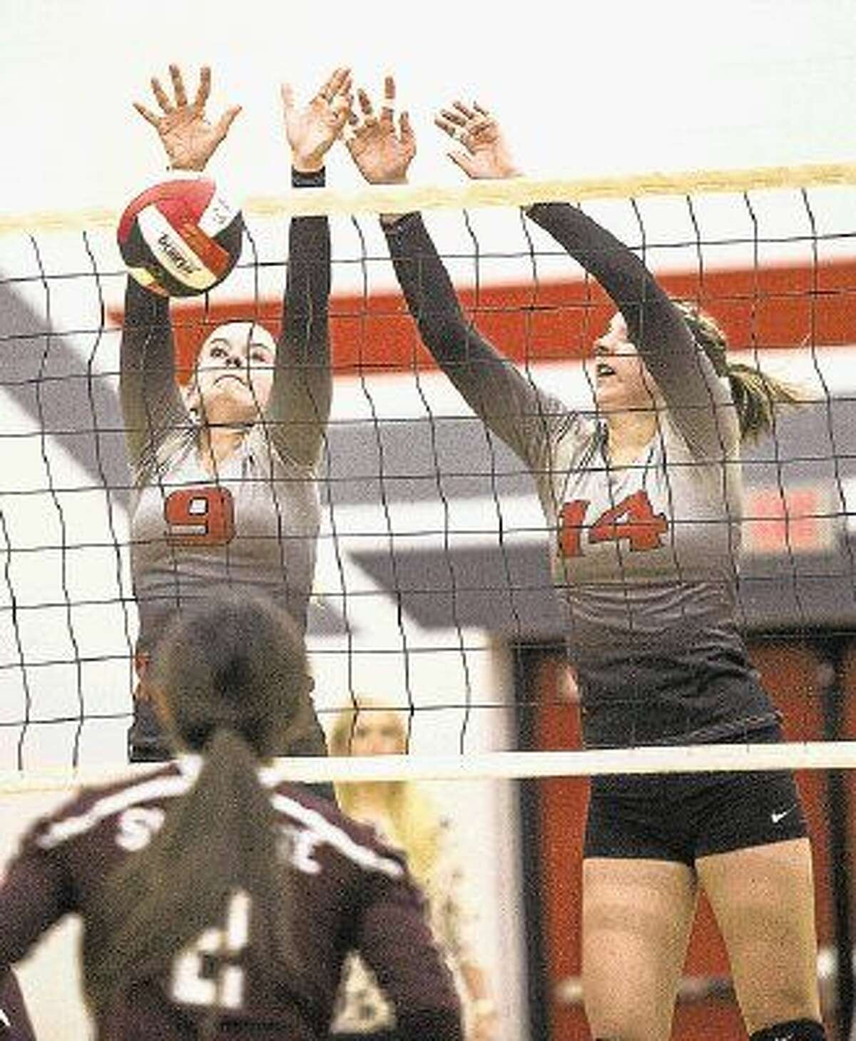 Huffman's Brittani Hashagen (9) and Ryan Drvendkar (14) block a spike during Huffman's 3-1 victory over Tarkington on Oct. 21, 2014, at Hargrave High School. Hashagen, along with the six other seniors on the team, will play a big role in Huffman's 2015 season.