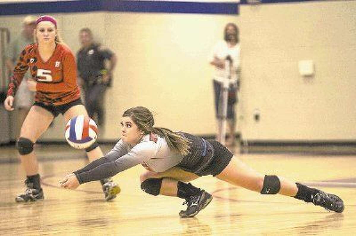 Huffman's Monica Shelton lunges for a dig during Atascocita's victory over Huffman on Sep. 2, 2014, at Atascocita High School.