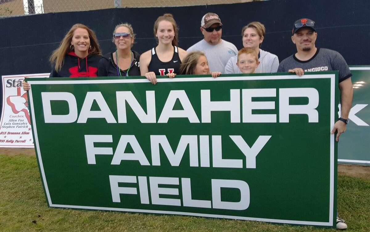 The Danaher Family pose with the field sign that will be displayed on the field named after Bob and Kelly Danaher at IT May Park during the 2016 Huffman Little League Opening Ceremonies Friday, April 1, 2016.