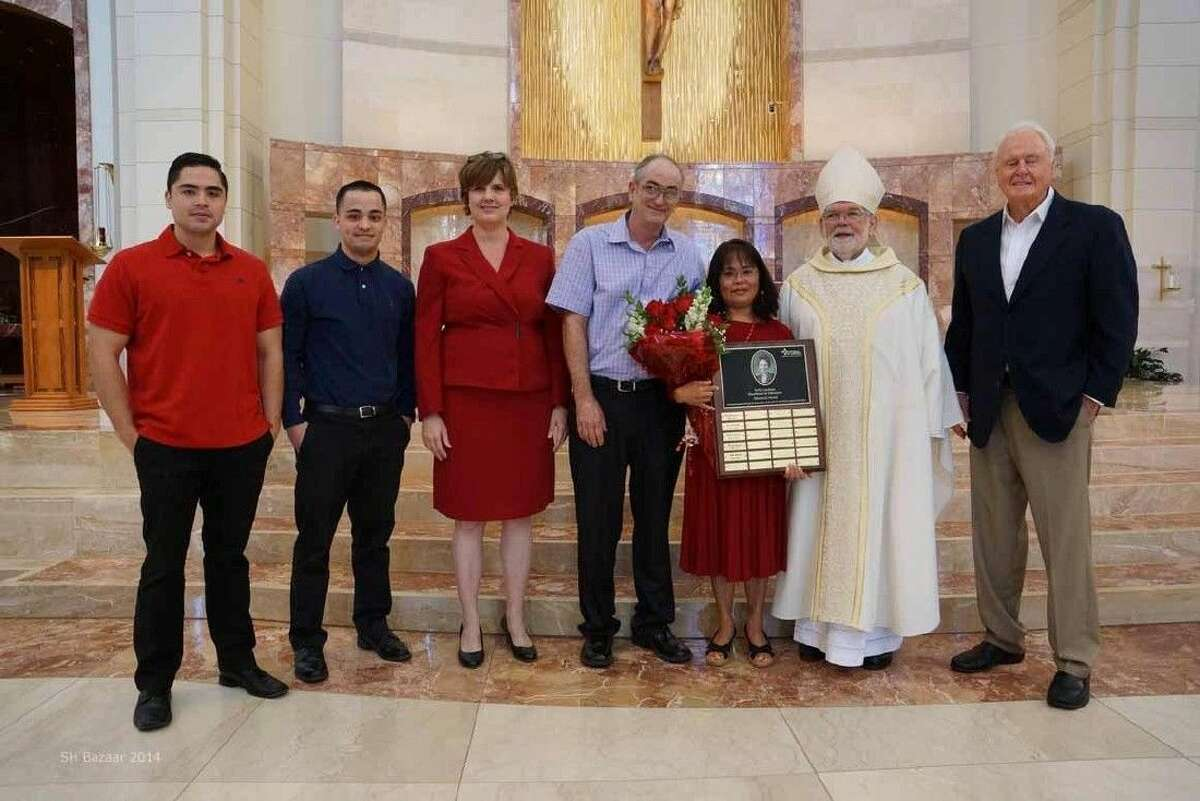Pictured from left: Mrs. Keister's sons, Dr. Julie Vogel, Supt. of Catholic Schools, AGH; Mr. Keister and award winner Mrs. Keister; Archbishop George Sheltz; Charles Landrum husband and founder of Sally Landrum award