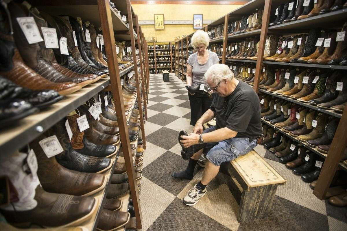 Janie and Bud Jackson of Kingwood browse the boot selection available at Cavender's new store Aug. 22, 2014, located at 9225 FM 1960 Bypass in Humble.