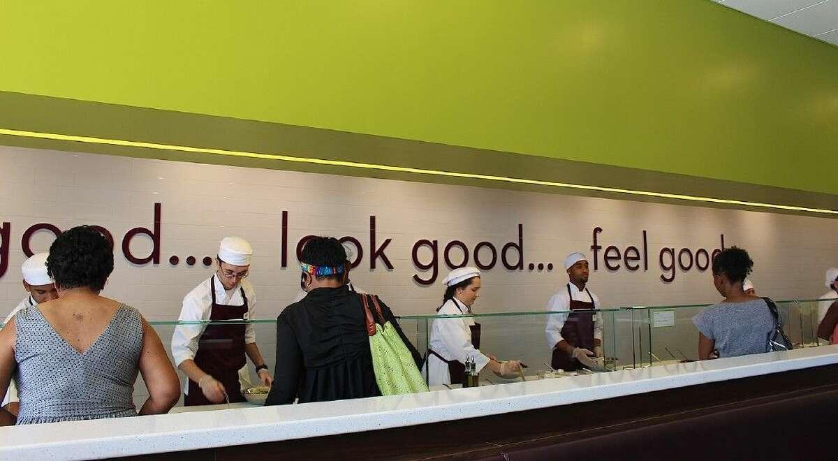 Customers customize their salads.