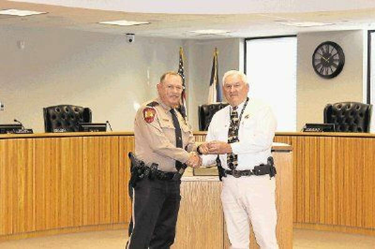 Montgomery County Sheriff Lt. James Fleming, pictured here with Sheriff Tommy Gage, was recently recognized for 35 years of service with Montgomery County.