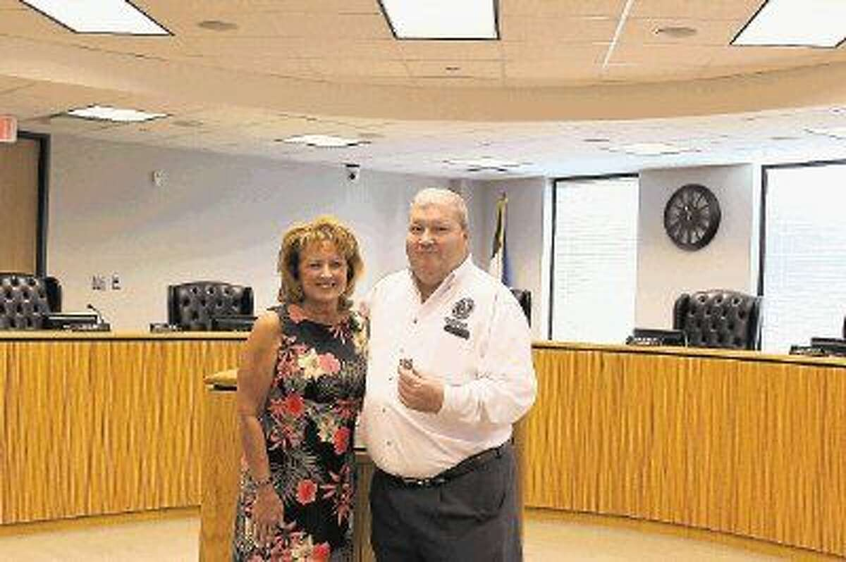 Marie Moore, pictured here with Precinct 4 Commissioner Jim Clark, was recently recognized for 35 years of service with Montgomery County.