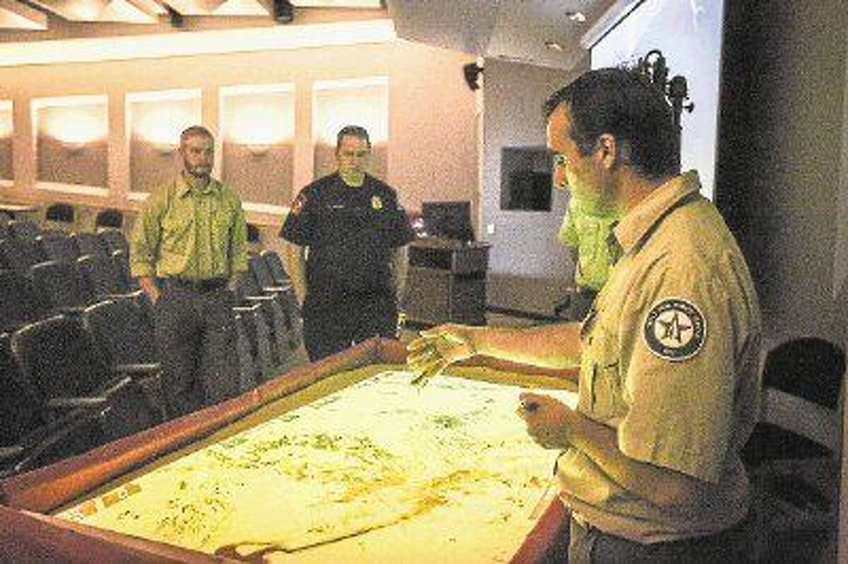 Geospatial Analyst Javier Vara Sanz, with the Texas Forest Service, discusses how the 3D wildfire simulation map functions on Friday at Lone Star College-Montgomery.