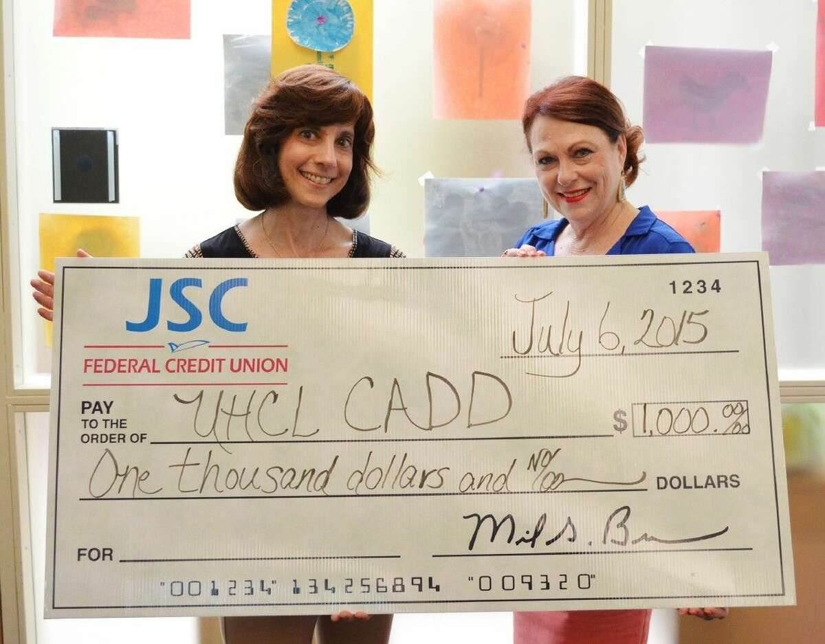 University of Houston-Clear Lake's Center for Autism and Developmental Disabilities will benefit from a $1,000 donation by the JSC Federal Credit Union. JSC Federal Credit Union Business Development Coordinator Becky Day (r) presented the check to Center for Autism and Developmental Disabilities Director Dorothea Lerman. The Credit Union has been longtime supporters of the center having remained a staunch supporter of the center's speaker series.
