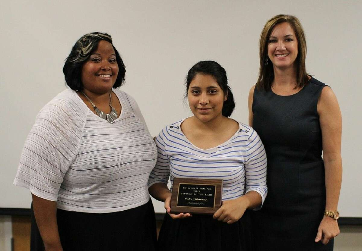 Upward Bound student Ester Jimenez, center, is recognized as the programs Student of the Year by advisor Sharmeal Archie, left, and director Regan Metoyer.