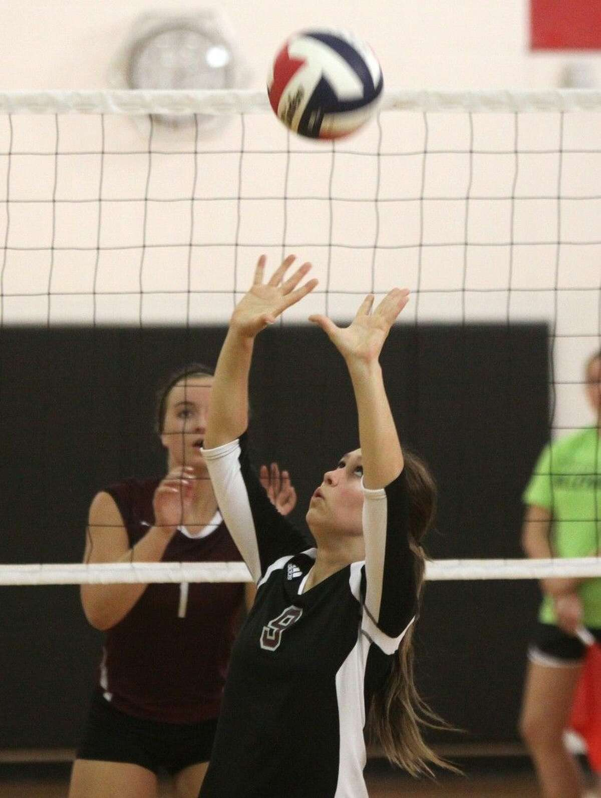 Pearland's Chelsey Watts sets the ball Thursday against Cinco Ranch during the Spring Branch ISD 2014 Varsity Tournament at Memorial High School in Houston.