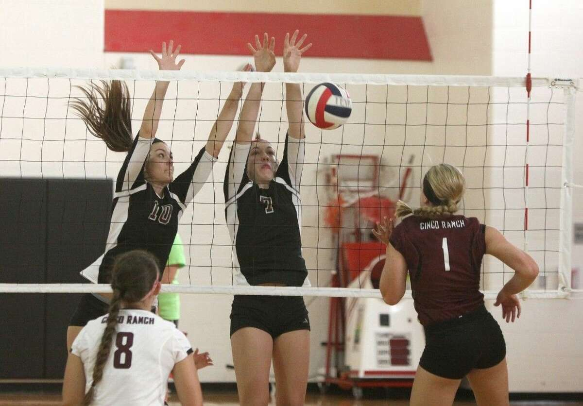 Cinco Ranch's Shea Madeley gets blocked by Pearland's Riley Murdock and Brooke Botkin during Thursday's action at the Spring Branch ISD 2014 Varsity Tournament at Memorial High School in Houston.
