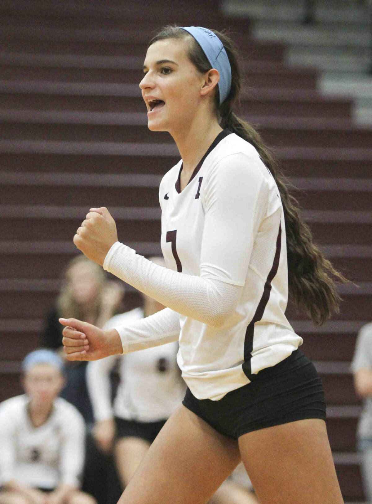 Magnolia's Morgan Miller celebrates after a point during a game at the Magnolia Volley Battle at Magnolia High School Thursday. To view or purchase this photo and others like it, visit HCNpics.com.