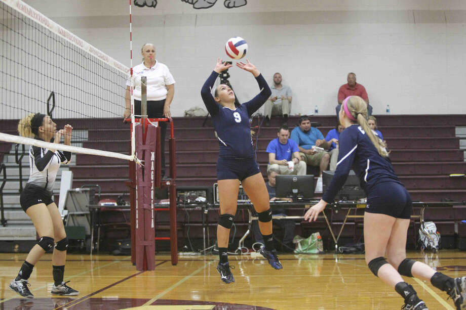 Concordia Lutheran's Adria Martinez sets the ball during a game at the Magnolia Volley Battle at Magnolia High School Thursday. To view or purchase this photo and others like it, visit HCNpics.com. Photo: Jason Fochtman
